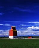 Grain truck drives away from grain elevator Stock Images