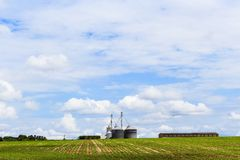 Grain warehouse in soy plantation in blue sky. Brazil, South America royalty free stock photos