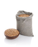 Grain of the wheat in bag and a bowl Stock Photos