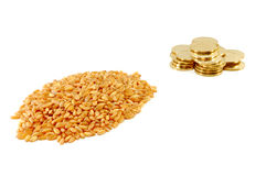 Grain of wheat and metal coins Stock Images