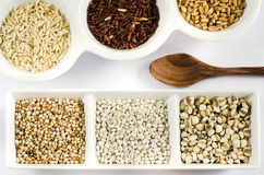 Grain and wooden spoon Royalty Free Stock Photography