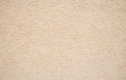 Grained beige wall background Stock Photo