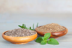 Grained and grinded chia seed. Healthy Chia seeds in wooden bowls. Grained and grinded chia seed Stock Photography