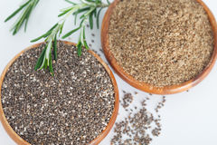 Grained and grinded chia seed in wooden bowls. Healthy eating, vegan diet concept Royalty Free Stock Photo