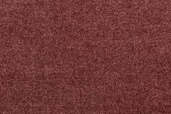 Grained texture fabric or textile material of red color Stock Photography
