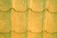 Grained yellow and green metal roof Stock Photos