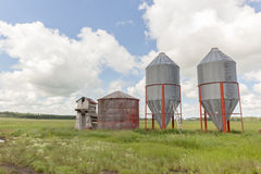 Graineries. Steel graineries with old wood grainery Stock Photography