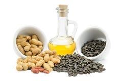 Graines, arachides et pétrole de tournesol Image stock