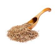 Graines d'aneth sur la cuillère en bois Image stock