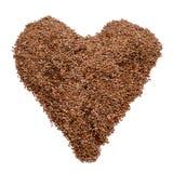 Graines de lin de Brown formant un coeur Image libre de droits