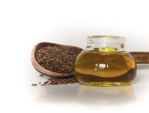 Graines de lin et pétrole de semence d'oeillette Photographie stock libre de droits
