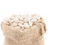 Graines des haricots dans un sac. Photo stock