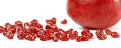 graines dispersées par grenade avant de fruit Photo libre de droits