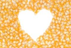 Graines en forme de coeur de maïs Photos stock