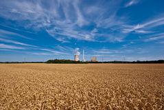 Grainfield and power plant Stock Photos