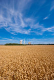 Grainfield and power plant. The picture shows a power plant and a grainfield royalty free stock photos