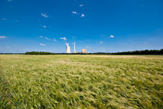 Grainfield and power plant. The picture shows a power plant and a grainfield royalty free stock images