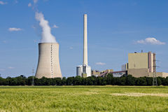 Grainfield and power plant. The picture shows a power plant and a grainfield Stock Images