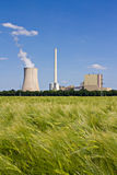 Grainfield and power plant. The picture shows a power plant and a grainfield stock photography