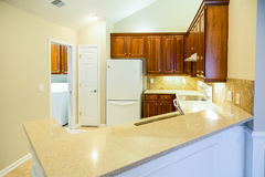 Grainite Countertops in Bright New Kitchen. A bright and modern kitchen with granite countertops Royalty Free Stock Photography