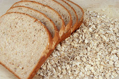 Grains. Slices of bread layed out on oats Stock Photo