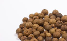 Grains of allspice on white. Background stock photography