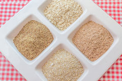 Grains. Assorted grains in a white platter Stock Photography