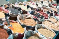 Grains and beans. Groceries in bulk bags at market Stock Image