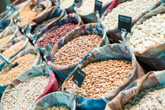 Grains and beans. Groceries in bulk bags at market stock photos