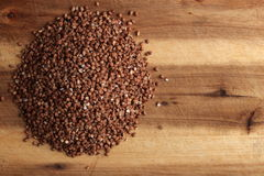 Grains of buckwheat on the wooden board Stock Images