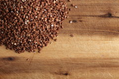 Grains of buckwheat on the wooden board Stock Photos