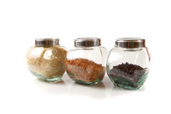 Grains and cereals in the glassy jars Stock Image