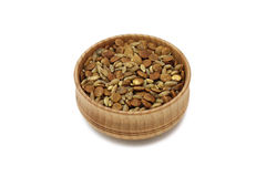 Grains and cereals in a wooden bowl Stock Photo