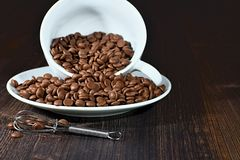 Grains Chocolate on the brown wooden table. Grains Chocolate with beater on the brown wooden table Stock Images