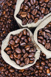 Grains of coffee in bags. Grains of coffee background Royalty Free Stock Images