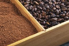 Grains of coffee, cocoa powder in a box Royalty Free Stock Photo