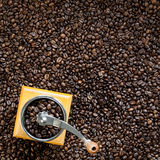 Grains of coffee and coffee-grinder Stock Images