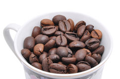 Grains of coffee are in a cup Stock Photos