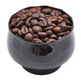 Grains of coffee are in a cup Royalty Free Stock Photography