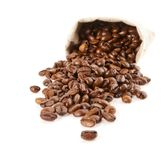 Grains of coffee pour out from a sack Stock Photography