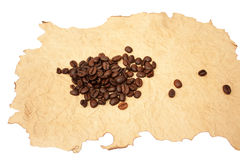 Grains of coffee on a singed paper Royalty Free Stock Photography