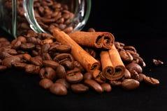 Grains of coffee and stick cinnamon Stock Photos
