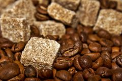 Grains of coffee and sugar slices Royalty Free Stock Images