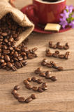 Grains of coffee on a wooden surface Royalty Free Stock Photography