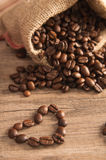 Grains of coffee on a wooden surface Royalty Free Stock Image