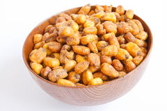 Grains corn fried. A cherry wood bowl of grains corn fried on a white background royalty free stock image