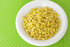 Grains of corn on green tablecloth Stock Images
