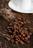 Grains and a cup of black coffee Royalty Free Stock Photos