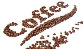 Grains de café écrits Photos stock