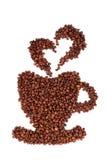 Grains de café étendus sous forme de tasse Photographie stock libre de droits